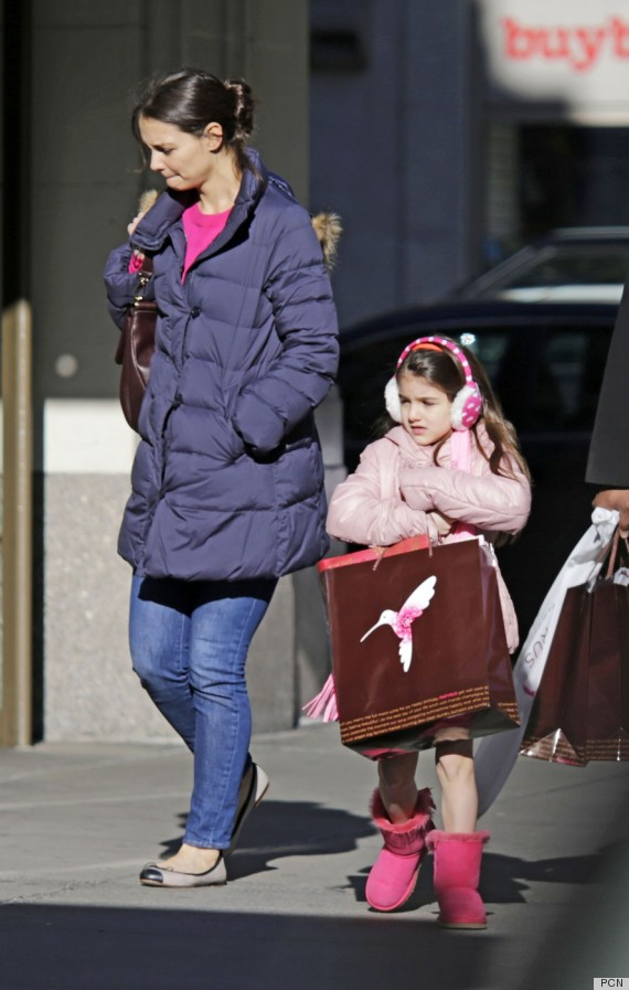 Katie Holmes and daughter Suri Cruise bundle up in their winter coats and ear muffs as they stop off at Papyrus in NYC for some last minute holiday shopping